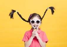 Smiling little girl eating ice cream. Isolated royalty free stock photo