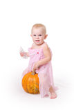 Smiling little girl embraces a pumpkin Royalty Free Stock Photos