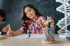 Smiling little girl enjoying art lesson at school Stock Photography