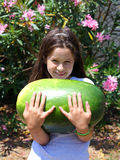 Smiling little girl with an enormous WATERMELON Stock Photo