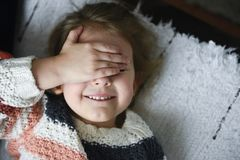 Smiling little girl eyes closed royalty free stock photo