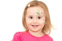 Smiling little girl with face-art Stock Photography