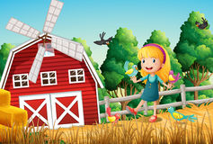 A smiling little girl at the farm with the birds Royalty Free Stock Image