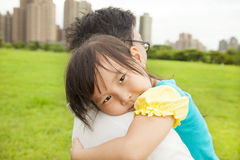 Smiling little girl  on  father shoulder at city park Royalty Free Stock Photos