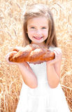 Smiling little girl on field of wheat Royalty Free Stock Images
