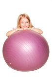 Smiling little girl with fitness ball. Isolated on white Stock Images
