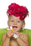 Smiling little girl with flowers Stock Photography
