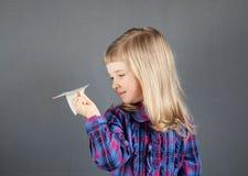 Smiling little girl flying paper plane Stock Photography