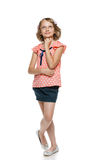 Smiling little girl in full length looking up stock images