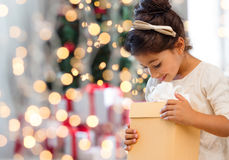 Smiling little girl with gift box Royalty Free Stock Image
