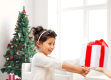 Smiling little girl with gift box Royalty Free Stock Photography