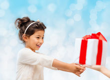 Smiling little girl with gift box Stock Photography