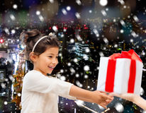 Smiling little girl with gift box Stock Image