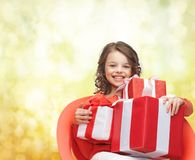 Smiling little girl with gift boxes Stock Photos