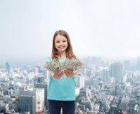 Smiling little girl giving dollar cash money Royalty Free Stock Photography
