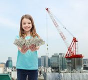 Smiling little girl giving dollar cash money Royalty Free Stock Image