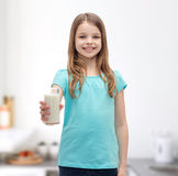 Smiling little girl giving glass of milk Royalty Free Stock Photos