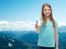 Smiling little girl giving glass of water Stock Photography