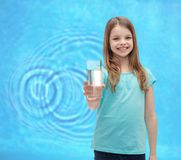 Smiling little girl giving glass of water Stock Photos