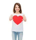 Smiling little girl giving red heart Royalty Free Stock Images