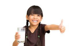 Smiling little girl with a glass of milk Royalty Free Stock Images