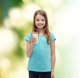Smiling little girl with glass of milk Royalty Free Stock Photography