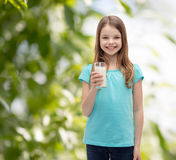 Smiling little girl with glass of milk Royalty Free Stock Photos