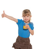 Smiling little girl with a glass of orange juice Royalty Free Stock Image