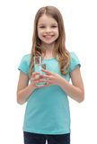 Smiling little girl with glass of water Stock Photo