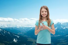 Smiling little girl with glass of water Stock Images