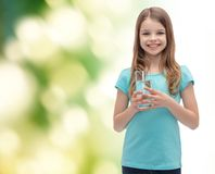 Smiling little girl with glass of water Royalty Free Stock Photos