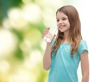 Smiling little girl with glass of water Stock Image
