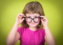 Smiling little girl with glasses Stock Photos