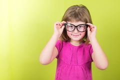 Smiling little girl with glasses Stock Photo