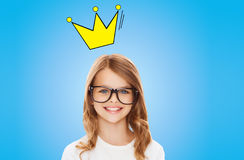 Smiling little girl in glasses with crown Royalty Free Stock Photo