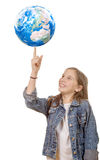 Smiling little girl with globe isolated on white background Royalty Free Stock Photos