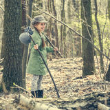 Smiling little girl goes through the woods Stock Images