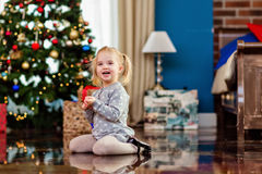 Smiling little girl in a gray dress on the background of the Chr Royalty Free Stock Image