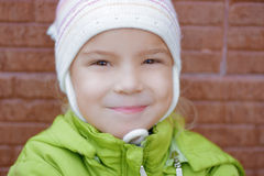 Smiling little girl in green jacket Royalty Free Stock Images