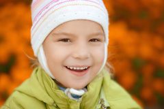 Smiling little girl in green jacket Royalty Free Stock Photos