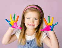 Smiling little girl with hands in the paint Royalty Free Stock Photos