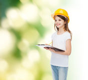 Smiling little girl in hardhat with clipboard Royalty Free Stock Photo