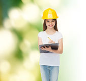 Smiling little girl in hardhat with clipboard Stock Photos