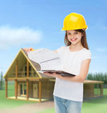 Smiling little girl in hardhat with clipboard Royalty Free Stock Photos