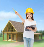 Smiling little girl in hardhat with clipboard Stock Images
