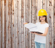 Smiling little girl in hardhat with clipboard Royalty Free Stock Images