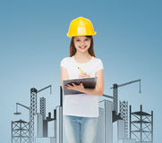 Smiling little girl in hardhat with clipboard Stock Photo