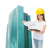 Smiling little girl in hardhat with clipboard Stock Photography