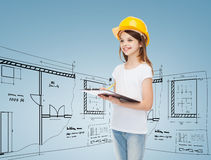 Smiling little girl in hardhat with clipboard Royalty Free Stock Photography