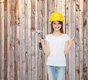 Smiling little girl in hardhat with hammer Royalty Free Stock Photography
